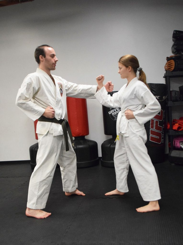 Teen Girl Taking a Private Lesson from a Sensei
