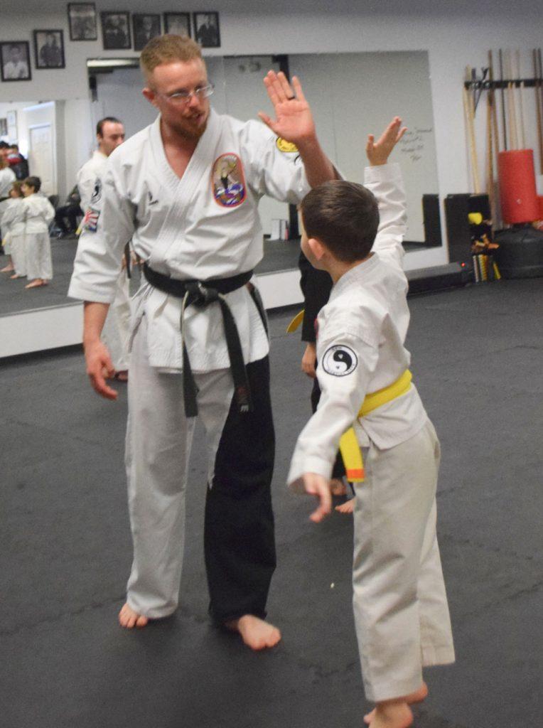 Sensei Zach encouraging a student