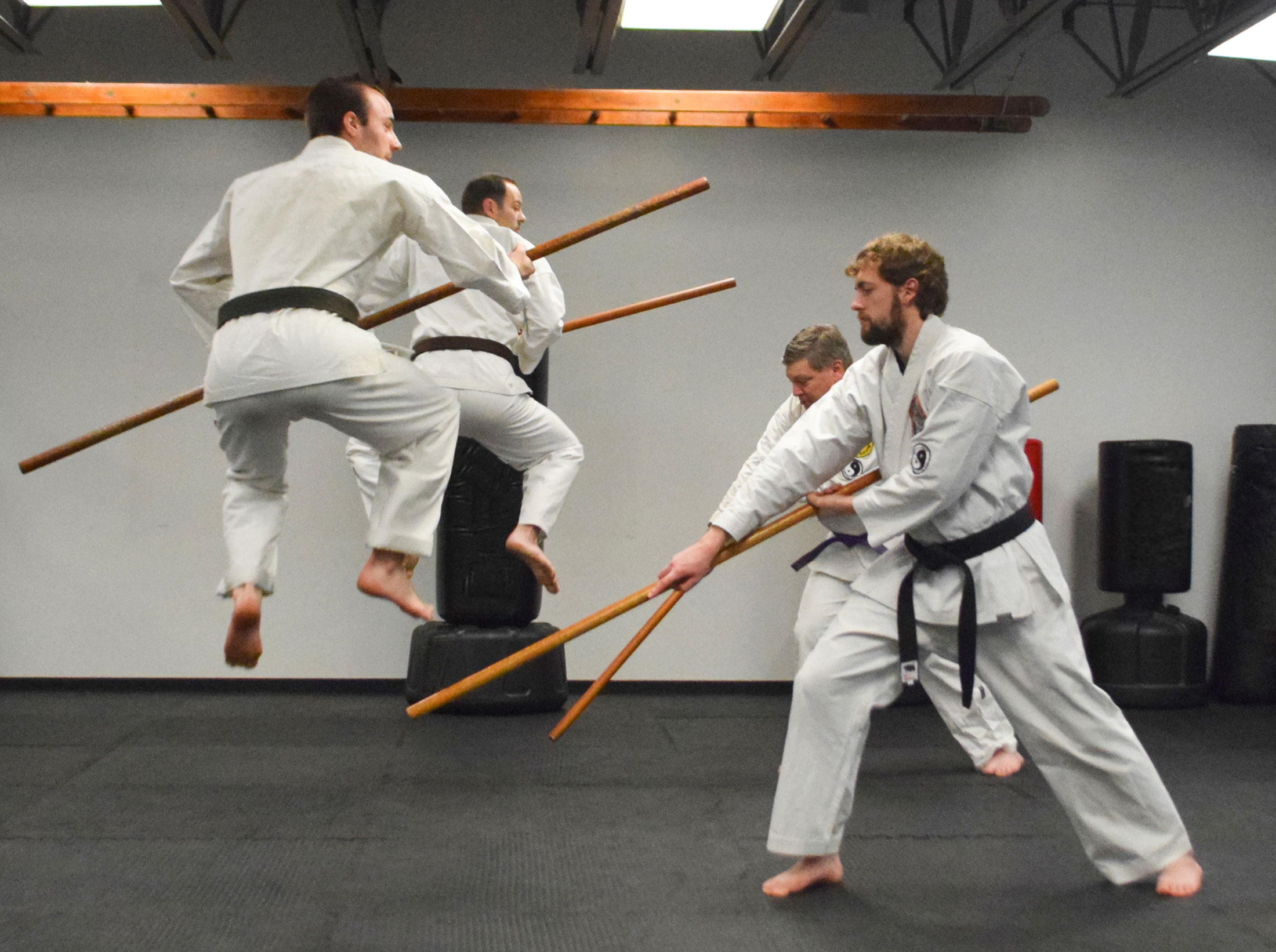 Men in the adult class practicing with bows