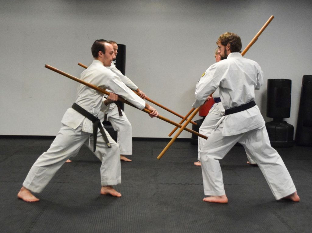 adult class practicing with bows