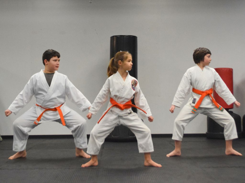 Orange belts practicing a stance